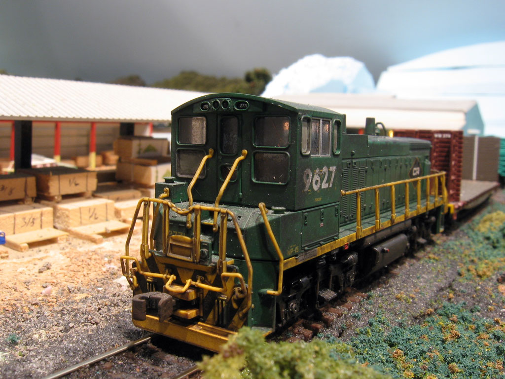 Here the switcher works the 84 Lumber before heading to the paper mill